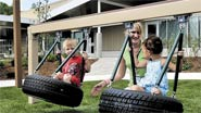 Children swinging on tires at Educare of Central Maine